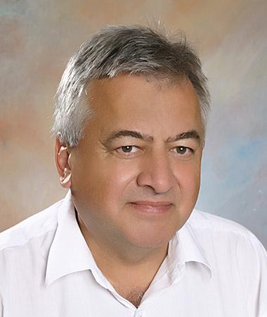 Dr. med. habil. Berbik István